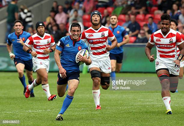 Baptiste Couilloud of France breaks to score a try during the World Rugby U20 Championship match between France and Japan at AJ Bell Stadium on June...