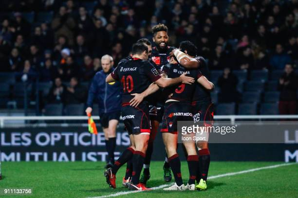 Baptiste Couilloud of Lyon and Lionel Beauxis of Lyon and Delon Armitage of Lyon during the Top 14 match between Lyon and Agen at Gerland Stadium on...
