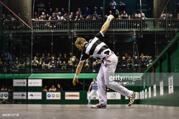 Baptiste Ducassou plays a shot during the final of the French championship of professional individual barehanded Basque Pelota against Mathieu...
