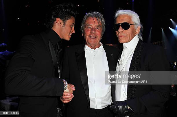 Baptiste Giabiconi Alain Delon and Karl Lagerfeld attend amfAR's Cinema Against AIDS 2010 benefit gala dinner at the Hotel du Cap on May 20 2010 in...