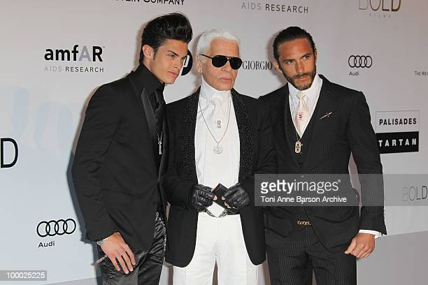Baptiste Giabiconi and Karl Lagerfeld and guest attend the amfAR Cinema Against AIDS 2010 at the Hotel du Cap during the 63rd Annual Cannes Film...
