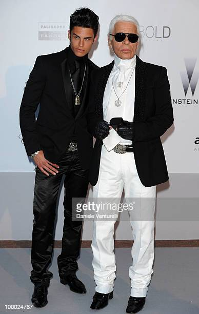 Baptiste Giabiconi and Karl Lagerfeld arrive at amfAR's Cinema Against AIDS 2010 benefit gala at the Hotel du Cap on May 20 2010 in Antibes France