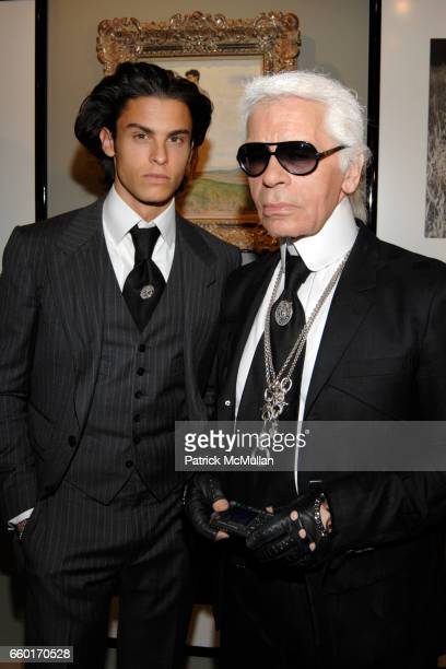 Baptiste Giabiconi and Karl Lagerfeld attend ART 40 BASEL Opening Day with GALERIE GMURZYNSKA at Art Basel Hall 2 on June 9 2009 in Basel Switzerland
