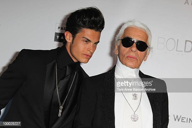 Baptiste Giabiconi and Karl Lagerfeld attend the amfAR Cinema Against AIDS 2010 at the Hotel du Cap during the 63rd Annual Cannes Film Festival on...