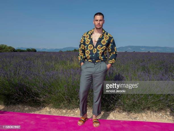 Baptiste Giabiconi attends the Jacquemus Spring Summer 2020 show on June 24, 2019 in Valensole, France.