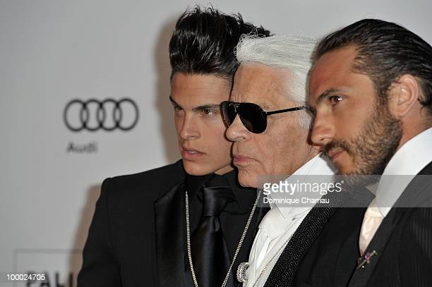Baptiste Giabiconi Karl Lagerfeld and Brad Kroenig arrive at amfAR's Cinema Against AIDS 2010 benefit gala at the Hotel du Cap on May 20 2010 in...