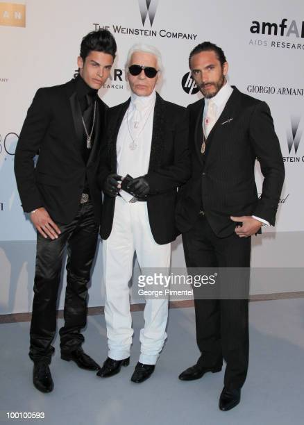 Baptiste Giabiconi Karl Lagerfeld and Brad Kroenig attend amfAR's Cinema Against AIDS Gala at the Hotel Du Cap during the 63rd International Cannes...
