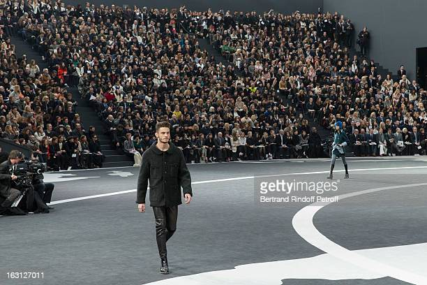 Baptiste Giabiconi walks the runway during the Chanel Fall/Winter 2013 ReadytoWear show as part of Paris Fashion Week at Grand Palais on March 5 2013...