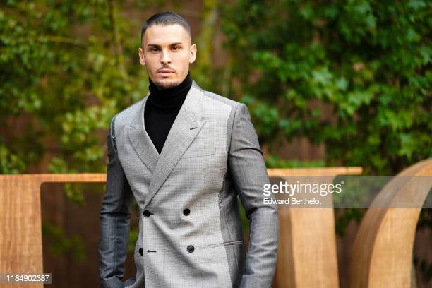 Baptiste Giabiconi wears a blazer jacket and a black turtleneck, outside Dior during Paris Fashion Week - Womenswear Spring Summer 2020, on September...
