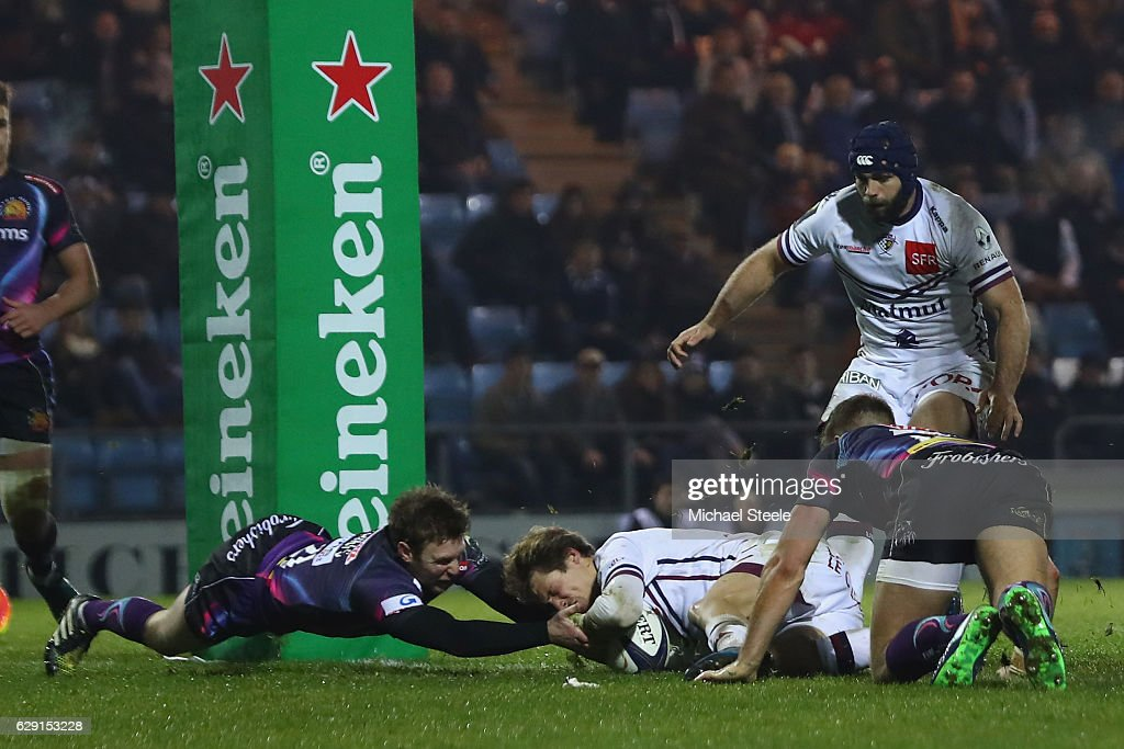 Baptiste Serin of Bordeaux scores his sides first try despite the challenge from Lachlan Turner of Exeter during the European Rugby Challenge Cup Pool 5 match between Exeter Chiefs and Bordeaux-Begles at Sandy Park on December 11, 2016 in Exeter, United Kingdom.