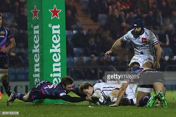 Baptiste Serin of Bordeaux scores his sides first try despite the challenge from Lachlan Turner of Exeter during the European Rugby Challenge Cup...