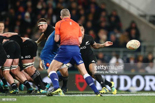Baptiste Serin of France is blocked by Referee John Lacey as Aaron Smith of the All Blacks setup a try to teammate Damian McKenzie during the...