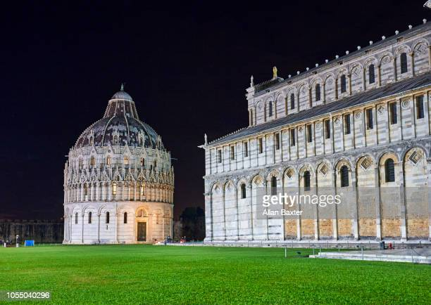 Baptistry and cathedral of Pisa illuminated at night