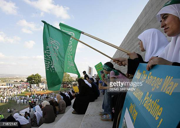 ArabIsraeli people attend a rally to condemn the Israeli offensive in Lebanon 28 July 2006 in the Arabic village of Baqa elGharbiya situated in east...