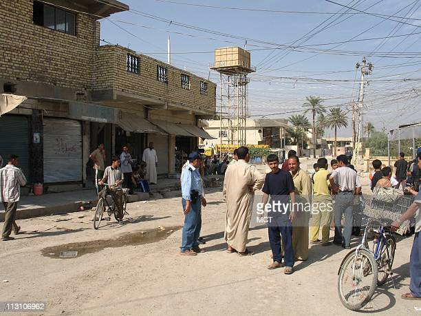 BAQUBAH IRAQ Baquba residents near a polling place October 14 where officials expect almost 100 percent voter turnout Almost everyone in this largely...
