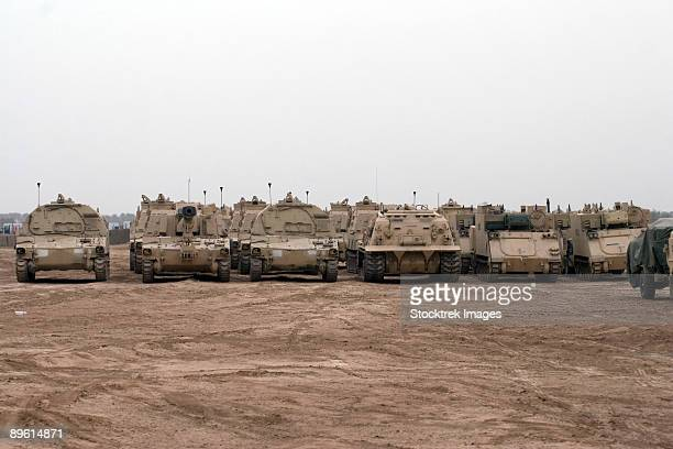 baqubah, iraq - a selection of m992 c.a.t or carrier ammunition tracked vehicles line up during a deployment with some m113 and m109 vehicles at camp warhorse. - baqubah fotografías e imágenes de stock