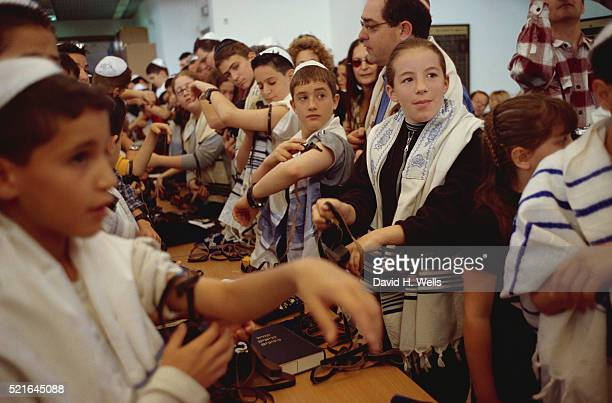 Bar and Bat Mitzvah Students Putting on Phylacteries