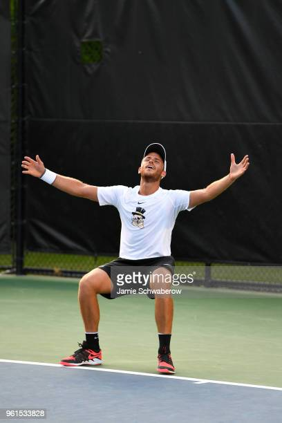 Bar Botzer of the Wake Forest Demon Deacons celebrates after defeating the Ohio State Buckeyes during the Division I Men's Tennis Championship held...