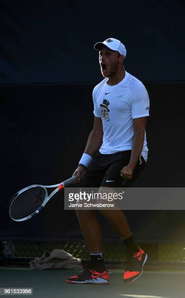 Bar Botzer of the Wake Forest Demon Deacons celebrates after winning his first set against the Ohio State Buckeyes during the Division I Men's Tennis...