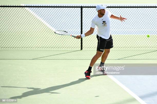 Bar Botzer of the Wake Forest Demon Deacons hits a return against the Ohio State Buckeyes during the Division I Men's Tennis Championship held at the...