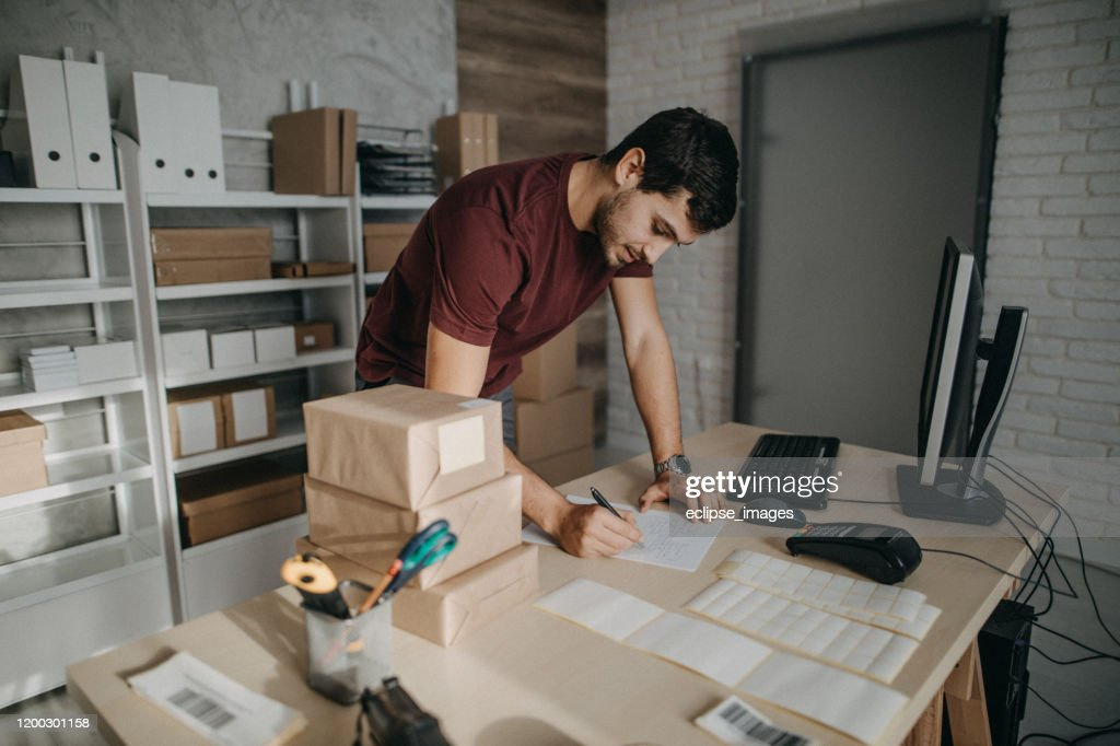 Bar codes helping me to organize packages : Stock Photo