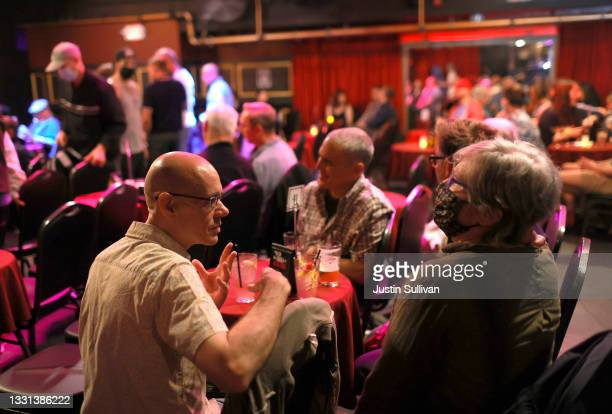 Bar customers talk at Oasis on July 29, 2021 in San Francisco, California. As COVID-19 begins to surge due to the Delta variant, The San Francisco...