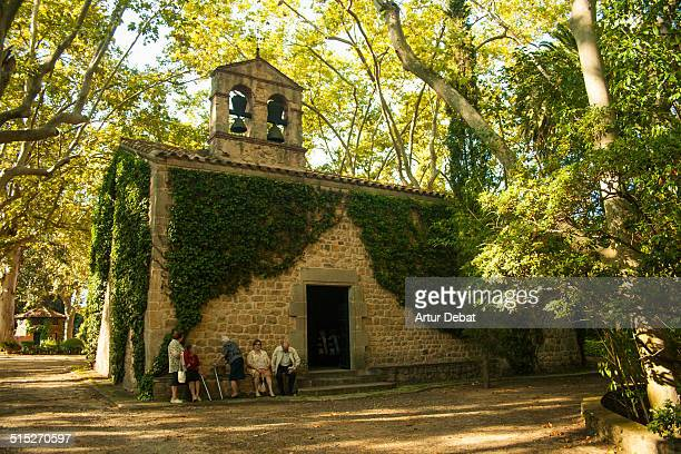 Baró de Viver church with people between the woods in the Argentona town Catalonia Europe