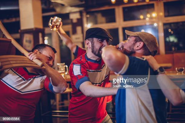 bar fight - hooligan stock pictures, royalty-free photos & images
