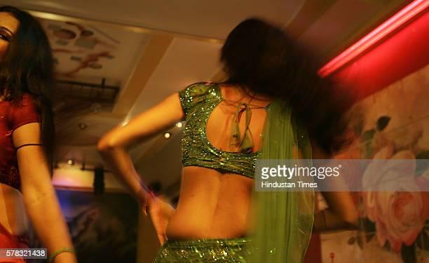 Bar girls dancing at a dance bar in Dadar