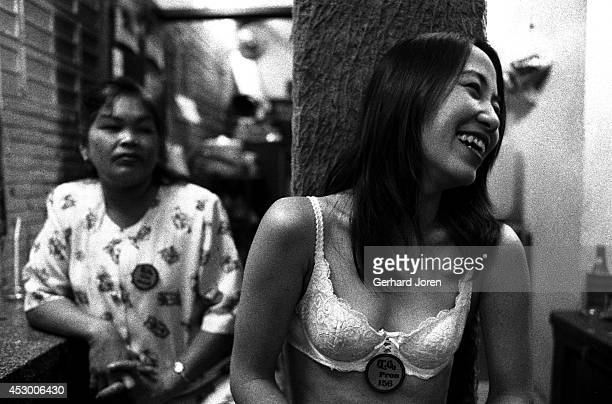 Bar girls relax backstage at the Tahitian Queen GoGo bar on Beach Road in Pattaya Customers can take a girl away from the bar for 500 Baht known as a...