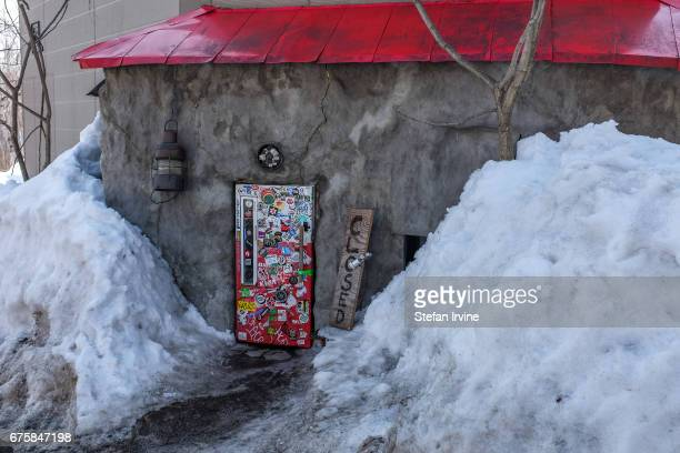 VILLAGE NISEKO HOKKAIDO JAPAN Bar Gyu also known as The Fridge Door Bar is famously hard to find and requires patrons to crouch down low into order...
