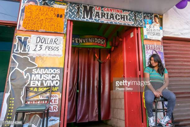 a bar in the red light district in downtown tijuana near the us-mexico border - crossing sign stock pictures, royalty-free photos & images