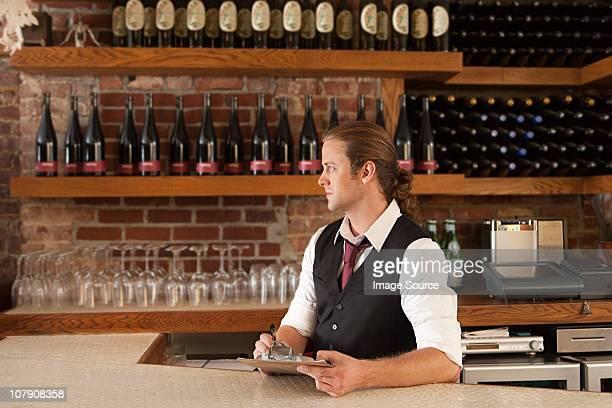 Bar manager looking at paperwork