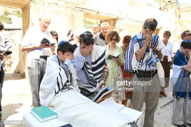 Bar Mitzva, a ceremony on a 13th birthday marking manhood for a Jewish boy, the boy, his father, and the Rabbi cover their eyes when they recite the...