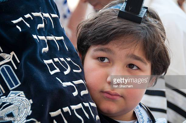 Bar Mitzvah Boy holding Torah book