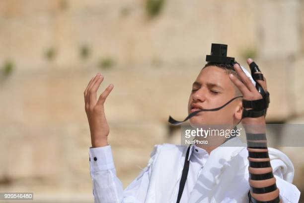 Bar mitzvah boy wearing tallit and tefillin at The Western Wall in the Old City of Jerusalem Wednesday 14 March 2018 in Jerusalem Israel