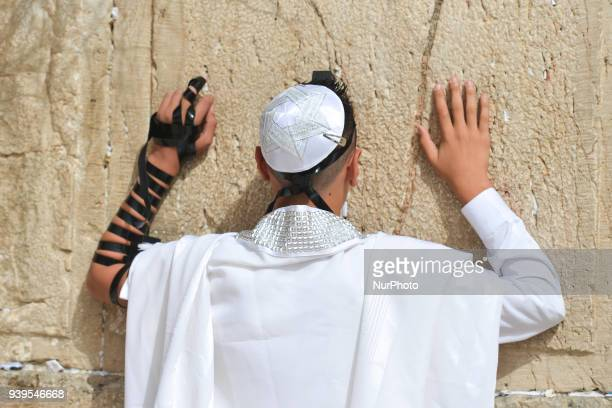 Bar mitzvah boy wearing tallit and tefillin at The Western Wall in the Old City of Jerusalem. Wednesday, 14 March 2018, in Jerusalem, Israel.