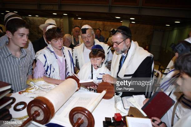 Bar Mitzvah the ceremony which marks manhood for a Jewish boy 13 years old taking place at the Western or Wailing Wall in Old Jerusalem the boy who...