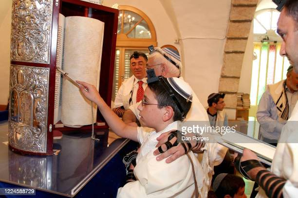 Bar Mitzvah, the ceremony which marks manhood for a Jewish boy, 13 years old, taking place at the Motza Ancient Synagogue, the boy who wears the...