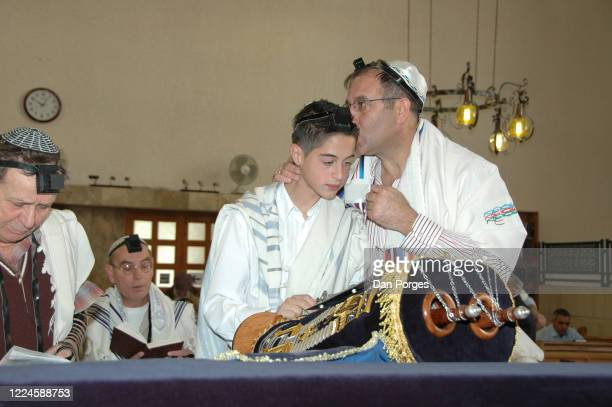 Bar Mitzvah the ceremony which marks manhood for a Jewish boy 13 years old taking place at the Shay Agnon Synagogue the boy who wears a talith or...