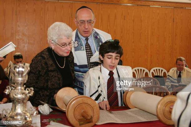 Bar Mitzvah, the ceremony which marks manhood for a Jewish boy, 13 years old, taking place at a Jerusalem synagogue where men and women worship...