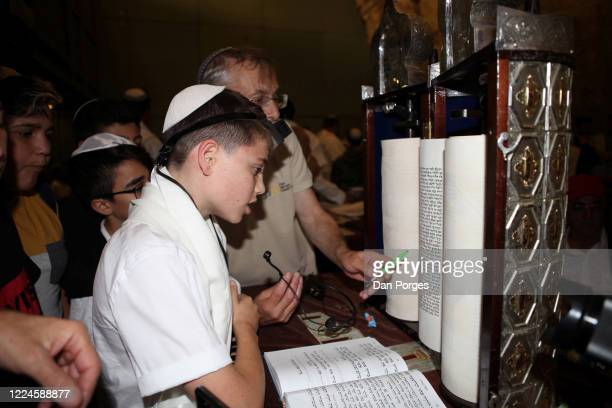 Bar Mitzvah, the ceremony which marks manhood for a Jewish boy, 13 years old, taking place at the Western or Wailing Wall in Old Jerusalem, the boy...