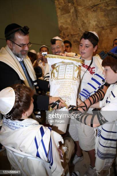 Bar Mitzvah the ceremony which marks manhood for a Jewish boy 13 years old taking place at the Western or Wailing Wall in Old Jerusalem the boy his...