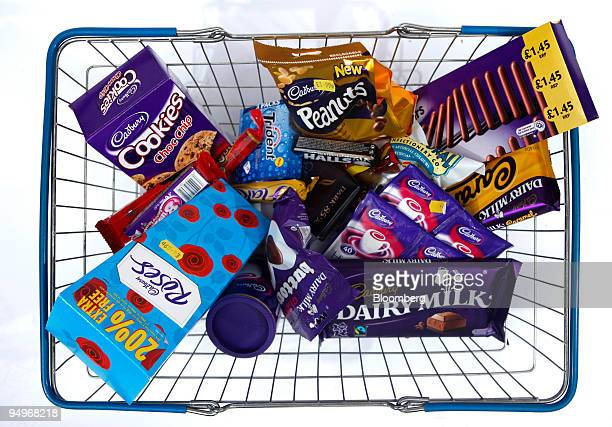 A bar of Cadbury dairy milk sits in a shopping basket along with a selection of Cadbury products in London UK on Wednesday Sept 9 2009 Kraft Foods...