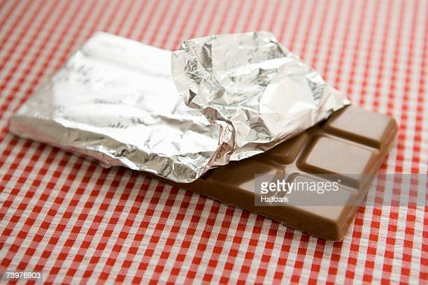 a bar of chocolate - candy wrapper stock photos and pictures