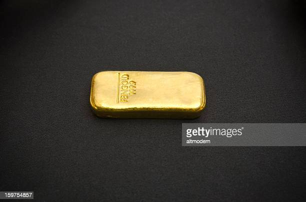 Bar of gold on a black background