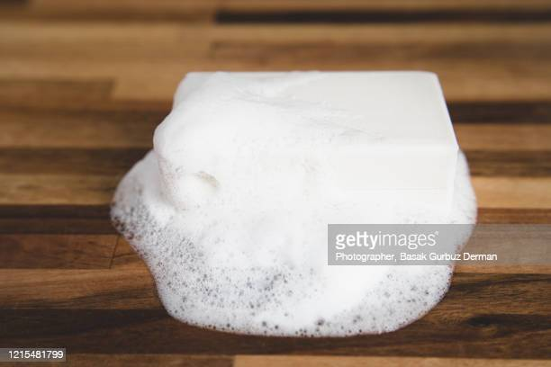 bar of soap with foam - foam material stock pictures, royalty-free photos & images