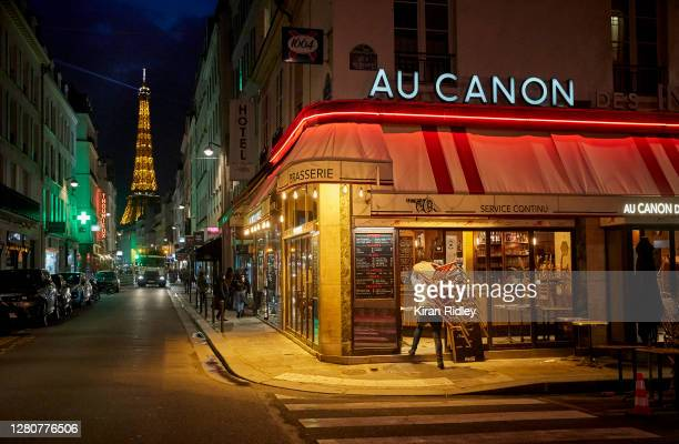 Bar owner closes up before the city wide curfew comes into effect in Paris at 9pm on October 17, 2020 in Paris, France. The nightly curfew, announced...
