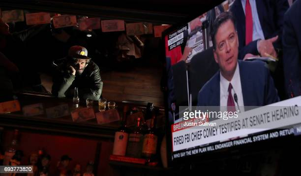 Bar patron at Ace's Bar watches a television broadcast as former FBI Director James Comey testifies before the Senate Intelligence Committee on June...