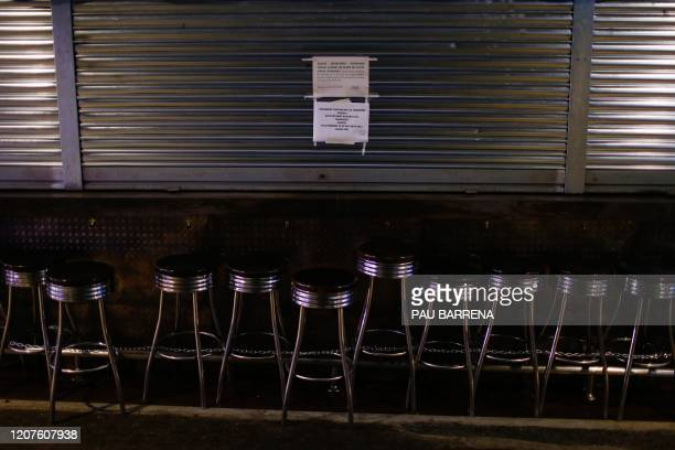Bar remains closed at the usually busy Boqueria food market in Barcelona on March 18, 2020. - Spain is the fourth hardest-hit nation in the world by...